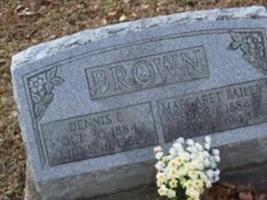 Dennis E Brown
